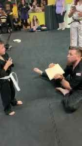 News video: Children in Karate Class Cheer Kid on While Kicking Board