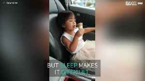 Girl struggles against sleep to eat ice cream [Video]