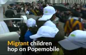 Pope treats migrant children to a ride on his popemobile [Video]