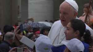 Pope gives migrant children ride on popemobile [Video]