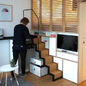 Loft equipped with retractable staircase gives business travelers a home away from home [Video]