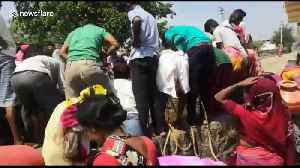 Indian families fetch water from 50-foot well in drought-hit village [Video]