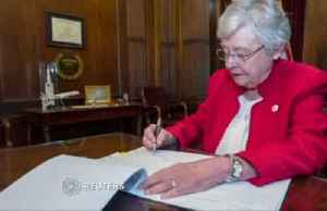 News video: Alabama governor signs strict abortion ban into law
