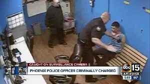 Phoenix officer charged with assault for slapping handcuffed man [Video]