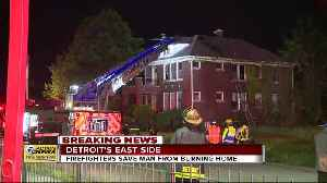 Firefighters save man from burning home on Detroit's east side [Video]