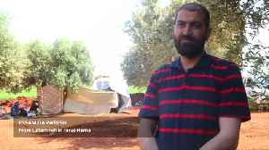 After fleeing bombs, Syrian families shelter in olive groves [Video]