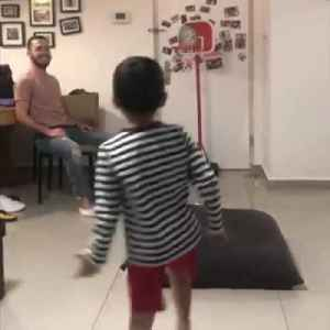News video: Little Boy Does Bicycle Kick and Shoots Soccer Ball Through Hoop