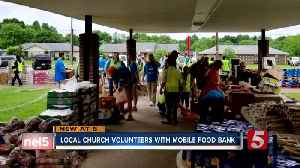 local church volunteers with mobile food bank [Video]
