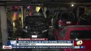 Fire burns vehicles in parking garage at University City apartment complex [Video]
