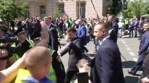 Ukraine's newly inaugurated president takes a stroll to his office [Video]