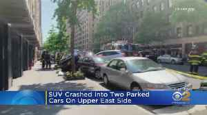 SUV Crashes Into 2 Parked Cars On Upper East Side [Video]