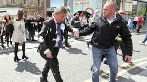 Man arrested after throwing milkshake at Nigel Farage [Video]