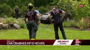 Luxury car crashes through several yards, hits house [Video]