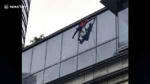 'Spiderman' spotted washing windows out of tall building in China [Video]