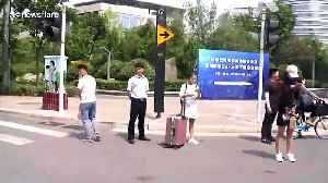 China opens world's first 5G self-driving bus line [Video]