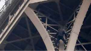 Man climbing Eiffel Tower convinced to come down and given to authorities [Video]