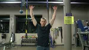 He holds a world record for pull-ups. His day job is just as impressive [Video]