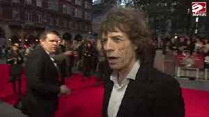 The Vaccines recall awkward group fist pump with Sir Mick Jagger [Video]