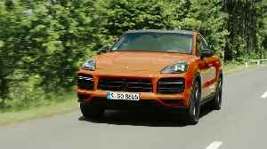 The new Porsche Cayenne Turbo Coupé in lava orange Driving Video [Video]