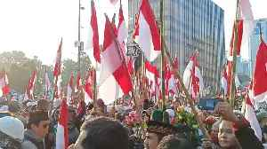 Crowds Rally at Jakarta Election Offices After Incumbent President's Victory [Video]