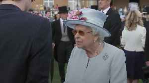 Queen mingles with guests at annual garden party