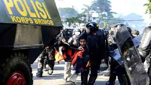 Jakarta on alert as protests after election loss turn violent