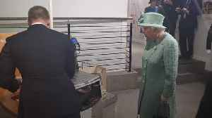 Queen shown how self-service machine works on trip to replica Sainsbury's store [Video]