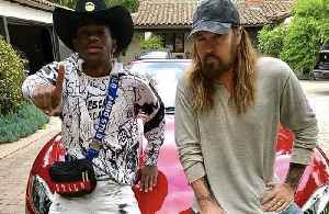 Billy Ray Cyrus gifted Maserati by Lil Nas X [Video]
