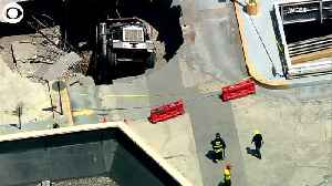 WEB EXTRA: Dump Truck Through Parking Garage Roof [Video]