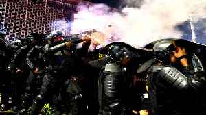 Jakarta clashes rage in second night of unrest over poll result [Video]