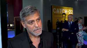 News video: George Clooney's production partner vowed to give up bikes as he held actor's head in his arms