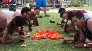 Weird party game in the Philippines sees people race to lick an ice lolly clean [Video]