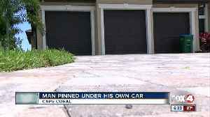 Man pinned between SUV and garage suffers serious injuries [Video]