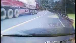 Heroic car driver jumps into driverless lorry to stop it from sliding down Chinese highway [Video]