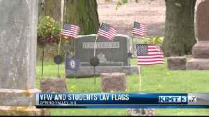 Placing flags in Spring Valley [Video]