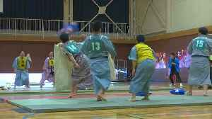 Japanese compete to qualify in national pillow fighting tournament