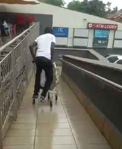 Man Falls Trying to Ride Shopping Cart Down a Slippery Ramp [Video]