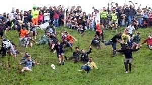 Annual Cheese Rolling Competition In Gloucestershire [Video]