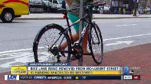 After a debate between drivers and cyclists, the city plans to remove the E. Monument St bike lanes [Video]