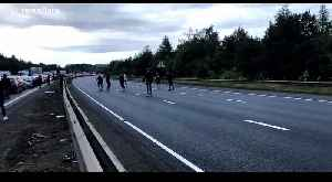 Football fans play kick-about during traffic gridlock on closed M1 [Video]