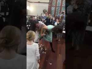 Female Wedding Guests Fight over Bridal Bouquet [Video]