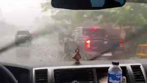Huge hailstones batter cars during unseasonal storm in the Philippines [Video]