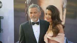 George Clooney and Amal Clooney offer up doble date for charity [Video]