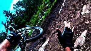 Mountain biker performs flawless tuck-and-roll wipe out [Video]