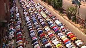 News video: Muslim prayers spill over into street on the last Friday of Ramadan