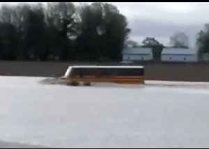 School Bus Drives Through Deep Floodwaters in West Illinois [Video]