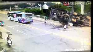 Men escape death after large crane flips over in China's Jiangxi [Video]