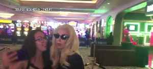 Fans pose with Lady Gaga impersonator [Video]