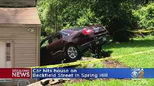 Car Crashes Into Spring Hill House [Video]