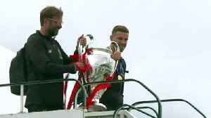 Liverpool players arrive home following Champions League win [Video]